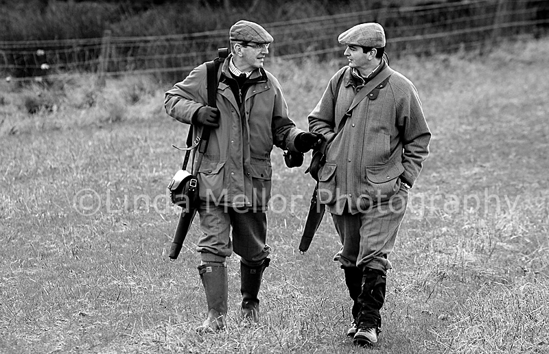 Black And White Image Of Two Guns Talking On Way Back From Drive