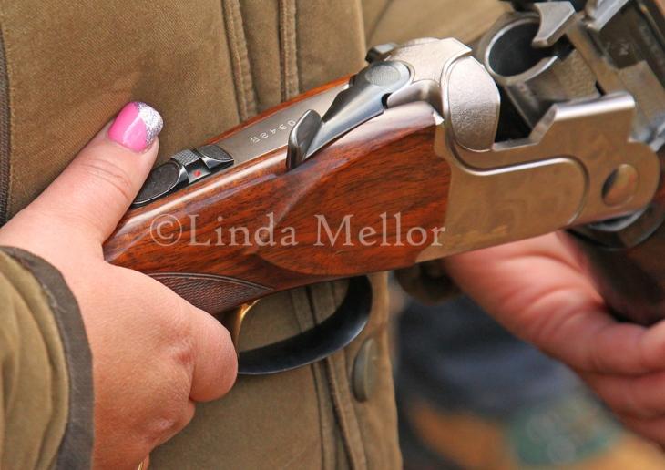 Pink nails and shotguns