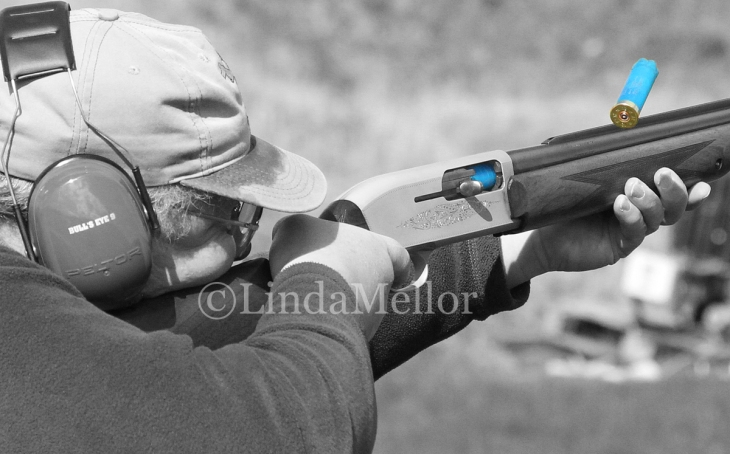 Catching the action of a semi automatic shotgun ejecting spent shells