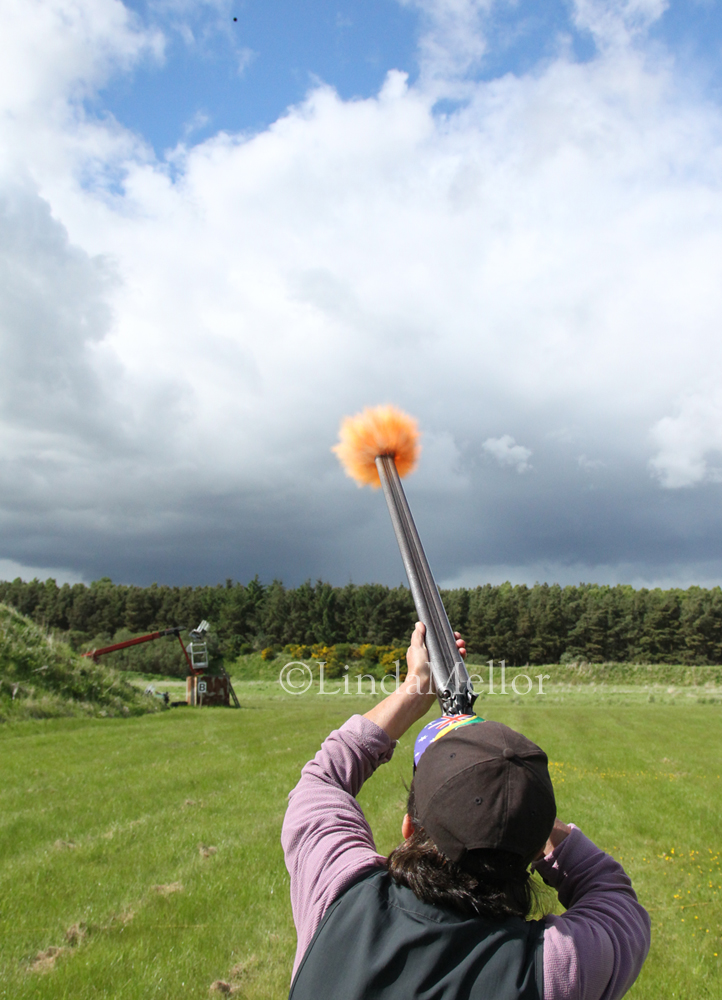 Black powder muzzle loading shotgun clay shooting competition, high shutter speed capture of flames