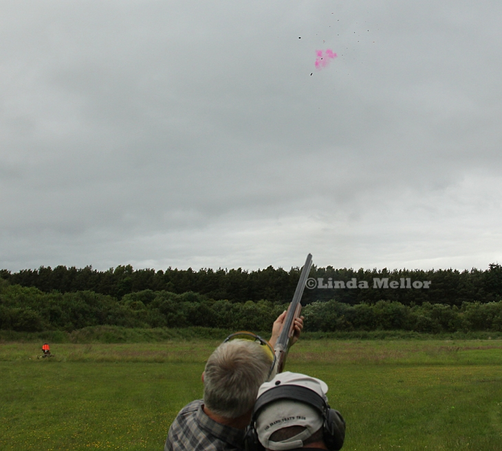 Shooting flash clays at the Scottish clay shooing centre in Fife