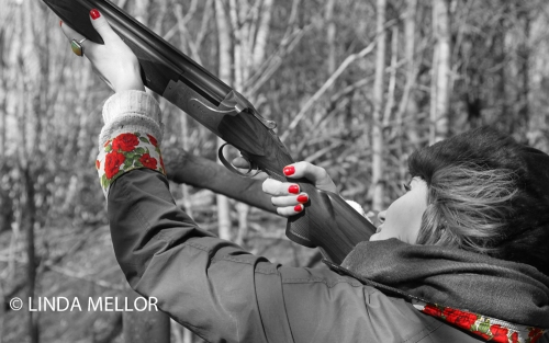 A  glamorous approach to clay shooting with a lady gun wearing red nail varnish.