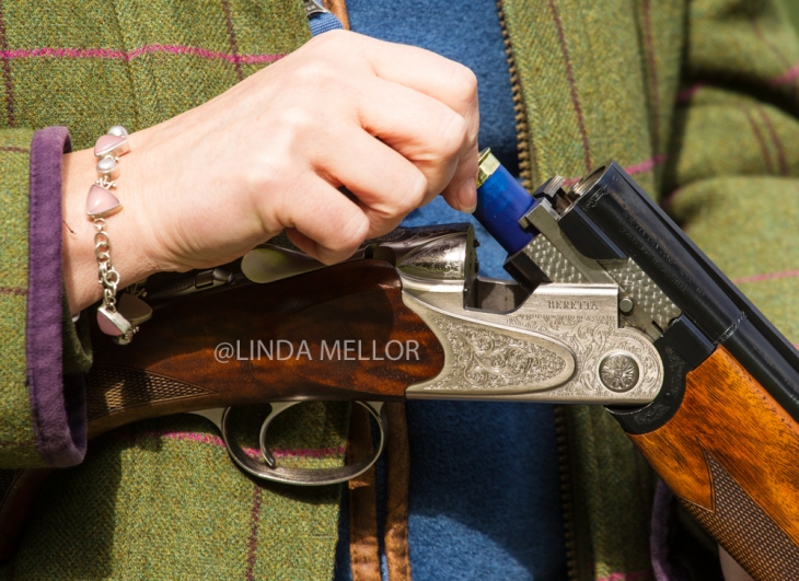 A shooting lady close up image of shotgun detail and tweed